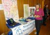 Anne Ambler works the NNWB table at the Clean Water Town Hall, Silver Spring Civic Center.