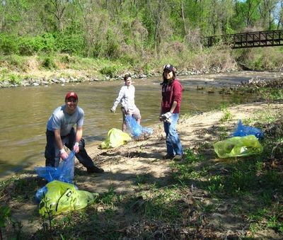 Volunteers bagging trash and recyclables along the Northwest Branch.
