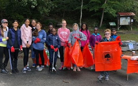 White Oak M.S. cleanup helpers holding empty bags