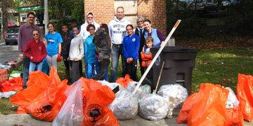 Participants pose with bags of litter--trash and compostables--from along the NW Branch.
