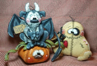 Gargoyle Protection Services primitive doll and Tender Curses VooDoo primitive doll.