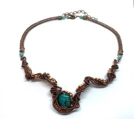 Chrysocolla copper breast plate in a hand woven Viking knit chain.