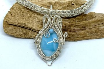 Wire woven larimar  on a hand woven Viking knit chain.