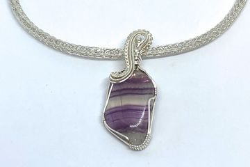 Fluorite with wire weave on a hand woven Viking Knit chain