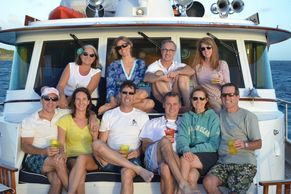 Family picture of guests  on motor vessel Bonaparte forward deck