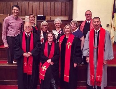 Pastor Allison (center, sitting) with Presbytery colleagues at her installation service.