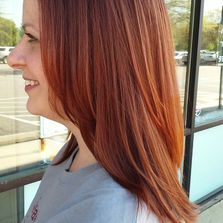 From dark blonde to red/ gold, long layered cut and style.