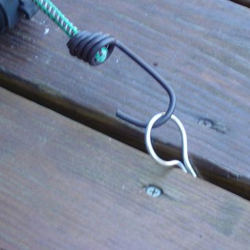 Deck-Tiedown is a simple to install tie down clip for decks and docks.  It is removable and reusable and will not damage the deck. Stainless steel is strong and durable.