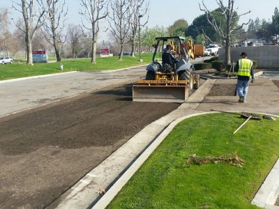 Asphalt removal and replacement for a damaged area within parking lot.