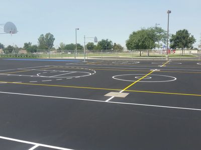 Seal Coating protects existing asphalt pavement from the elements and extends its life expectancy.