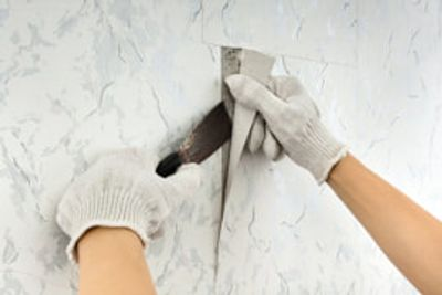 Wallpaper and other wallcovering removal is a tedious task to minimize damage to the drywall