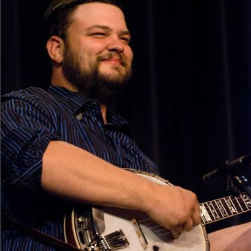 Josh Brooks, banjo and bluegrass, joined Honi & DreamGrass in 2004.