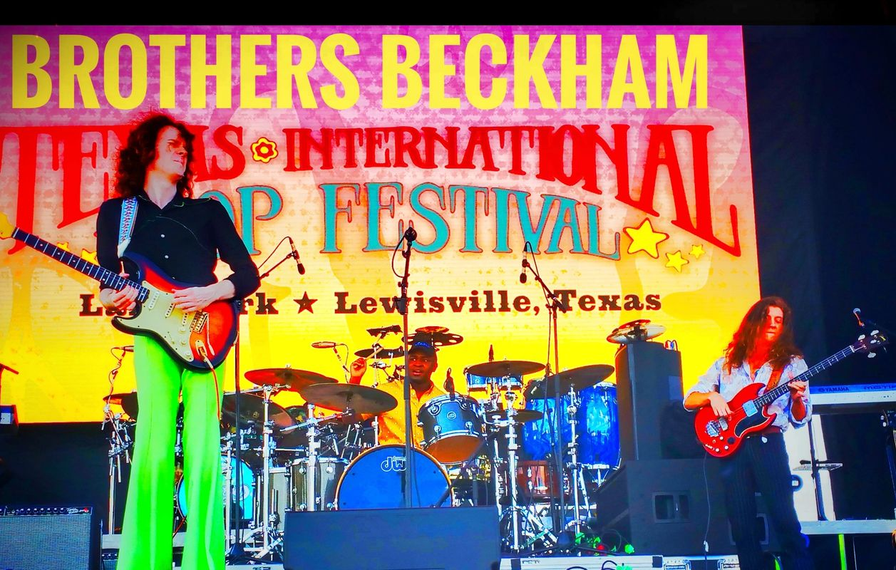 "{""blocks"":[{""key"":""cp4uj"",""text"":""Mason (guitar) & Mitch (bass) Beckham with Zeke Ratliff (drums) at the Texas International Pop Festival 9/1/2019"",""type"":""unstyled"",""depth"":0,""inlineStyleRanges"":[{""offset"":0,""length"":5,""style"":""BOLD""},{""offset"":17,""length"":5,""style"":""BOLD""},{""offset"":30,""length"":7,""style"":""BOLD""},{""offset"":71,""length"":32,""style"":""BOLD""},{""offset"":43,""length"":12,""style"":""ITALIC""}],""entityRanges"":[],""data"":{}}],""entityMap"":{}}"