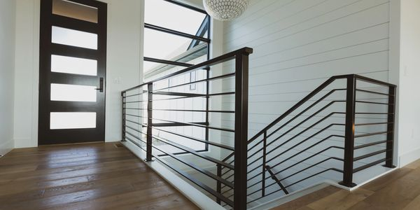 Entry and Stairs.  Powder-coated handrail and shiplap wall.