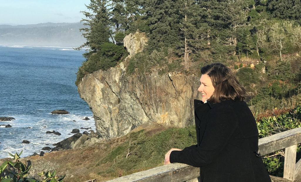 Photo of Kate Estikta looking out over the Pacific Ocean from Patrick's Point, CA