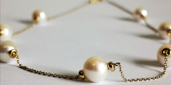 Real pearl and 9 carat gold necklace