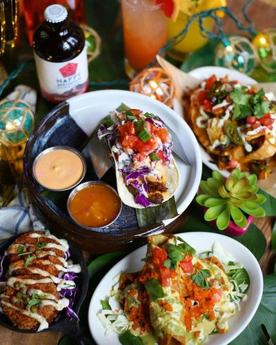 the best vegan noms & cocktails, in a fun beach bum glam shack with tropical party vibes