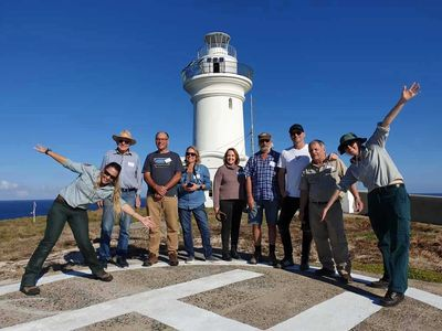 Walking Guided Tour, visitors on helipad infront of the Lighthouse on South Solitary Island, New Sou