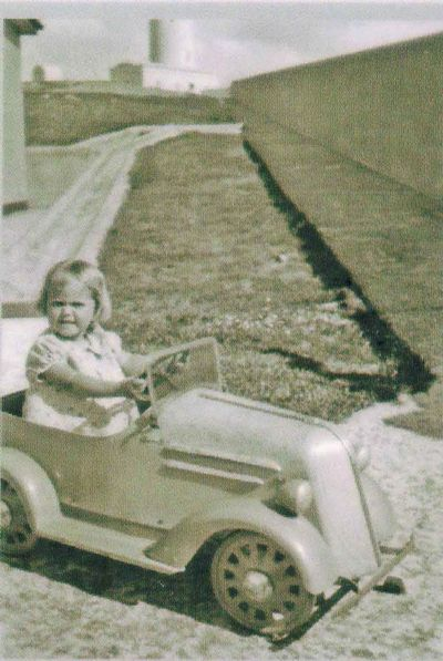 Fay Tulk in a pedal car - 1930's on South Solitary Island - Photo from Tulk Family, New South Wales