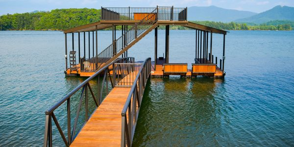 New dock with walk on top deck and ipe Brazilian hardwood with arched gangway and cantilevered stairs.