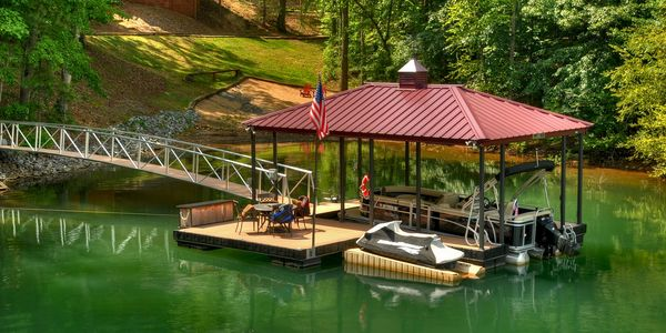 new boat dock with hip roof and cupola by Wahoo docks - arched gangway - ipe dock box - EZ Port PWC ramp