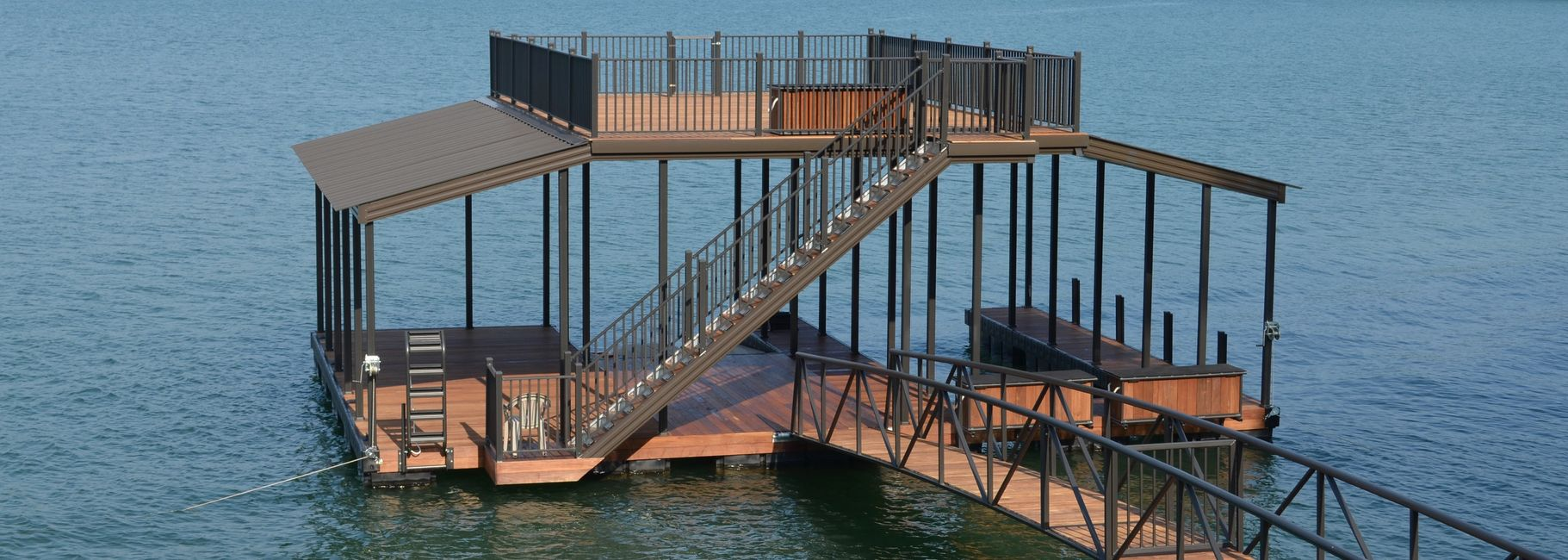 Wahoo custom dock with walk on top deck and arched gangway - all decking is ipe brazilian hardwood