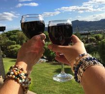 women wearing gemstone bracelets and sipping wine in Kelowna, British Columbia