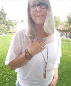 Beautiful woman smiling wearing her gemstone jewelry made by Bohemian Zen Wear