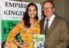 Actress Raquel Pomplun learns about THE ENGLISH SLAVE from author David Eugene Andrews at the EMPIRES AND KINGDOMS booth during Emmys Week 2017