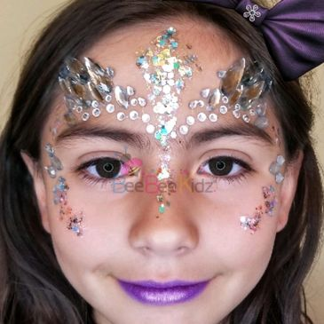 Face painting in Raleigh jewels face painting jewel glam