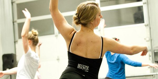A Springs Dance instructor leads dance class in Colorado Springs