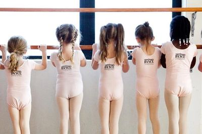 Kids dancers at the barre in a Springs Dance ballet class.