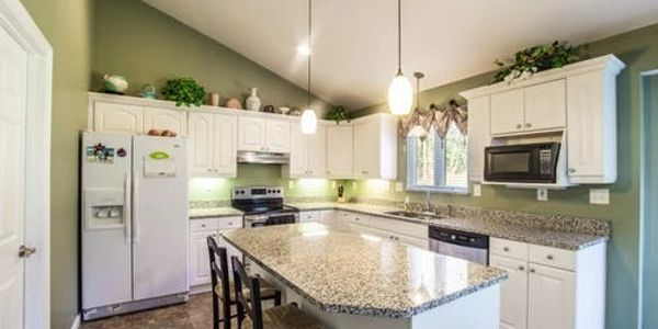 Newly Remodeled Kitchen.  Bright, and Open with lots of Cabinet space.  Large Island makes for a great gathering place.