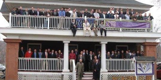 All of the brothers at 30 year, standing at the house.
