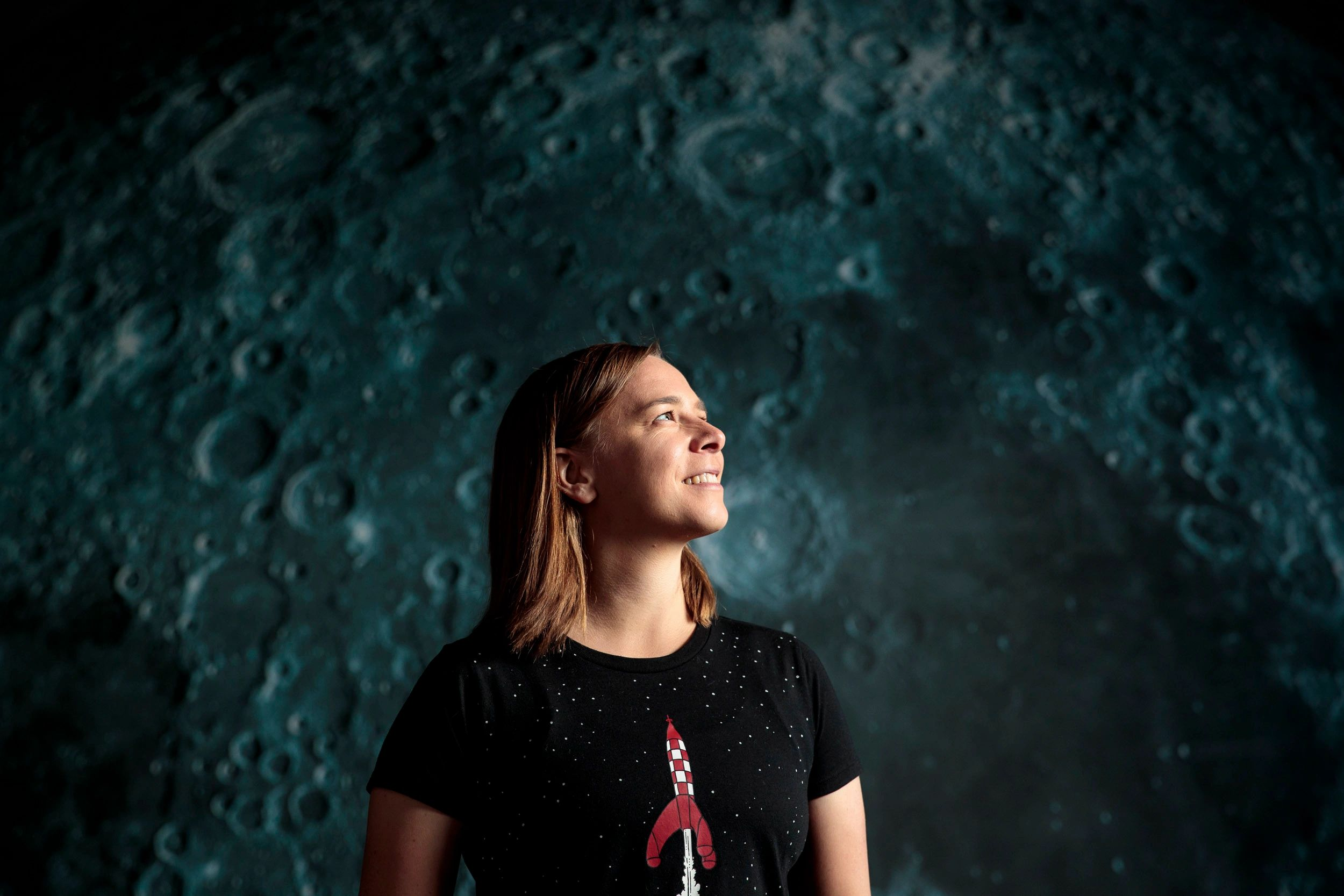 Professor Lisa Harvey-Smith, astronomer, author and Women in STEM ambassador looks up at the moon.