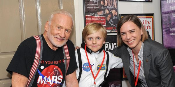 Buzz Aldrin and Lisa Harvey-Smith with Ethan, a young astronaut hopeful.