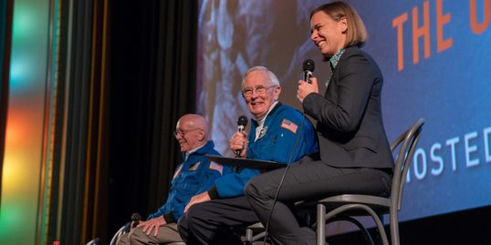 Professor Lisa Harvey-Smith with Apollo 16 astronaut Charlie Duke and flight director Gerry Griffin.