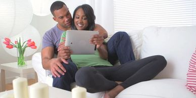 african american couple ipad computer home
