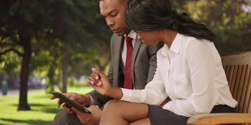 african american man african american woman business suit ipad computer