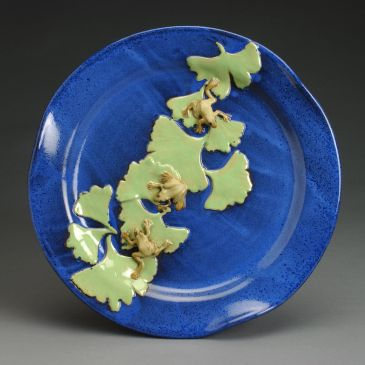 blue platter with green frogs and gingko leaf design
