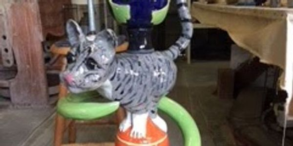 standing cat sculpture
