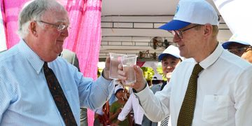 Mark and Murray share a glass of safe clean water.
