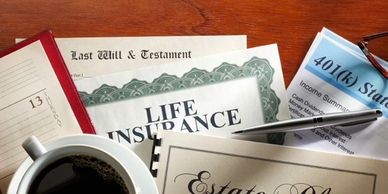 Image of a fictional person's vital documents, such as last will & testament, life insurance, estate plan, calendar, and a 401(k) statement, and a cup of coffee, all of which are lying on a wood tabletop