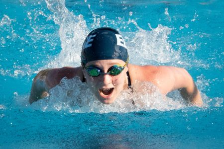 swimmer competes in the 50 fly