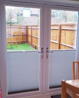 Perfect fit blinds fitted into two french doors