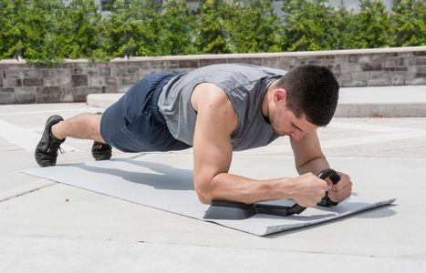The abmill plank trainer assists in creating perfect form while planking when working out your abs.