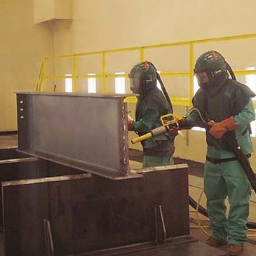 Blast room in operation, showing room interior, blast equipment and PPE