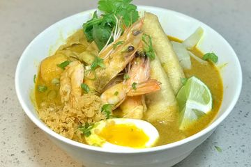 Curry Laksa Udon- Southeast Asia coconut curry soup. Chicken, fish ball, tofu and soft egg. Shrimp