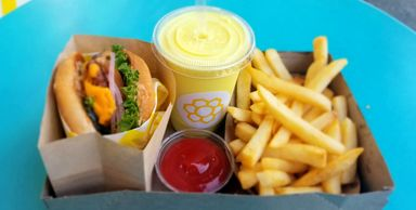 A combination box of slider burger, small shake, and fries.