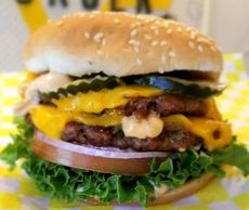 A double cheeseburger called the queen bee with impossible patties, violife cheese, and produce.